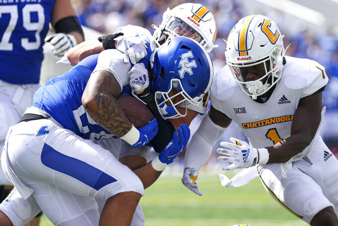 Kentucky running back Chris Rodriguez Jr. (24) gets tackled during the second half of a NCAA college football game against Chattanooga in Lexington, Ky., Saturday, Sept. 18, 2021. (AP Photo/Michael Clubb)