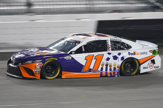 Denny Hamlin (11) drives into Turn 1 during a NASCAR Cup Series auto race Saturday, Sept. 12, 2020, in Richmond, Va. Hamlin who won Stage 1 was called for speeding in the pits and was penalized. (AP Photo/Steve Helber)