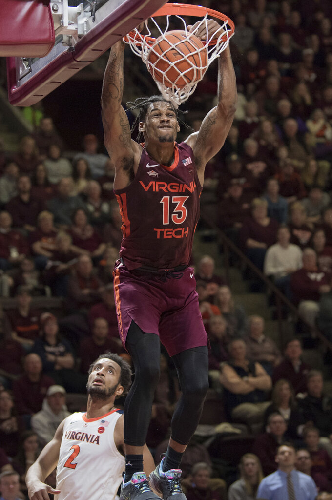 Virginia Tech guard Ahmed Hill (13) dunks against Virginia during the second half of an NCAA college basketball game in Blacksburg, Va., Monday, Feb. 18, 2019.(AP Photo/Lee Luther Jr.)