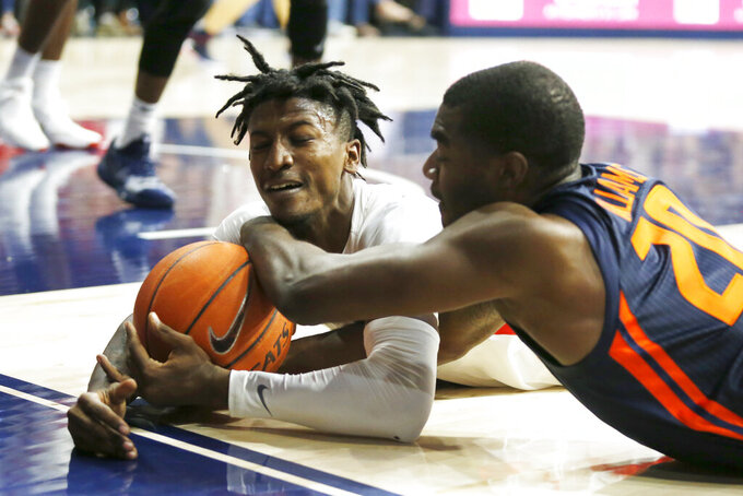 Arizona guard Dylan Smith, left, and Illinois guard Da'Monte Williams (20) scramble for the ball durikng the first half of an NCAA college basketball game Sunday, Nov. 10, 2019, in Tucson, Ariz. (AP Photo/Rick Scuteri)