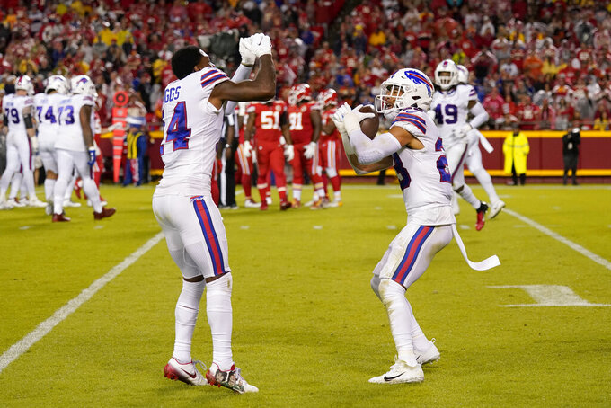 Buffalo Bills safety Micah Hyde, right, is congratulated by Stefon Diggs after running an interception back for a touchdown during the second half of an NFL football game against the Kansas City Chiefs Sunday, Oct. 10, 2021, in Kansas City, Mo. (AP Photo/Charlie Riedel)