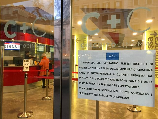 A notice in Italian outside a cinema reads: