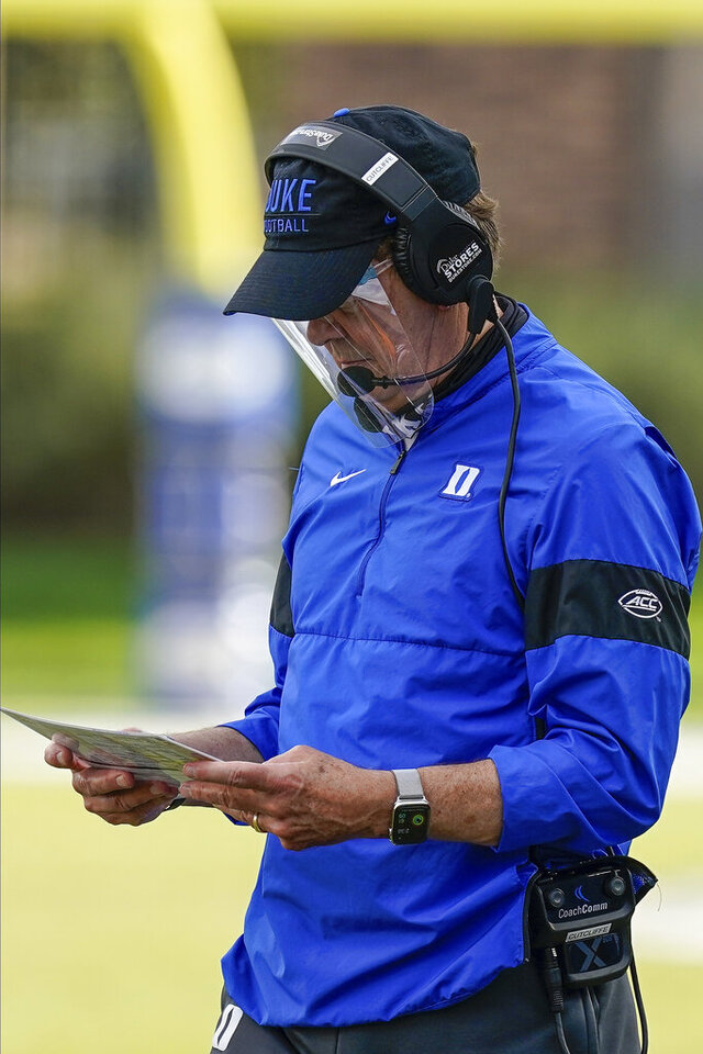 Duke head coach David Cutcliffe looks over a play card during a timeout against the North Carolina in the second half of an NCAA college football game at Wallace Wade Stadium, Saturday, Nov. 7, 2020, in Durham, N.C. (Jim Dedmon/Pool Photo via AP)