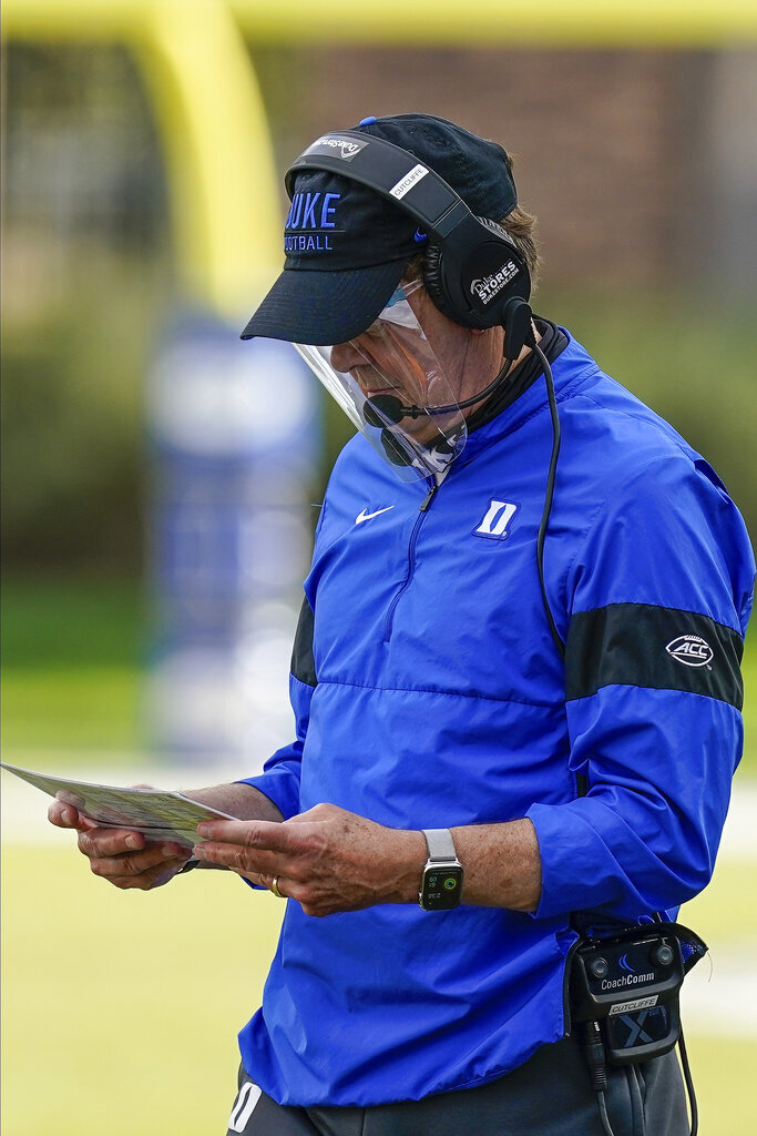 Duke head coach David Cutcliffe looks over a play card during a timeout against the North Carolina in the second half of an NCAA college football game at Wallace Wade Stadium, Saturday, Nov. 7, 2020, in Durham, N.C. (Jim Dedmon/Pool Photo via AP)
