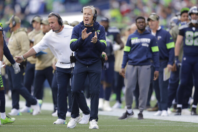 Seattle Seahawks head coach Pete Carroll calls to his team after tight end Jacob Hollister scored a touchdown against the Tampa Bay Buccaneers during the first half of an NFL football game, Sunday, Nov. 3, 2019, in Seattle. (AP Photo/John Froschauer)