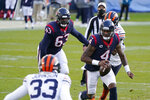 Houston Texans quarterback Deshaun Watson (4) runs during the second half of an NFL football game against the Chicago Bears, Sunday, Dec. 13, 2020, in Chicago. (AP Photo/Nam Y. Huh)