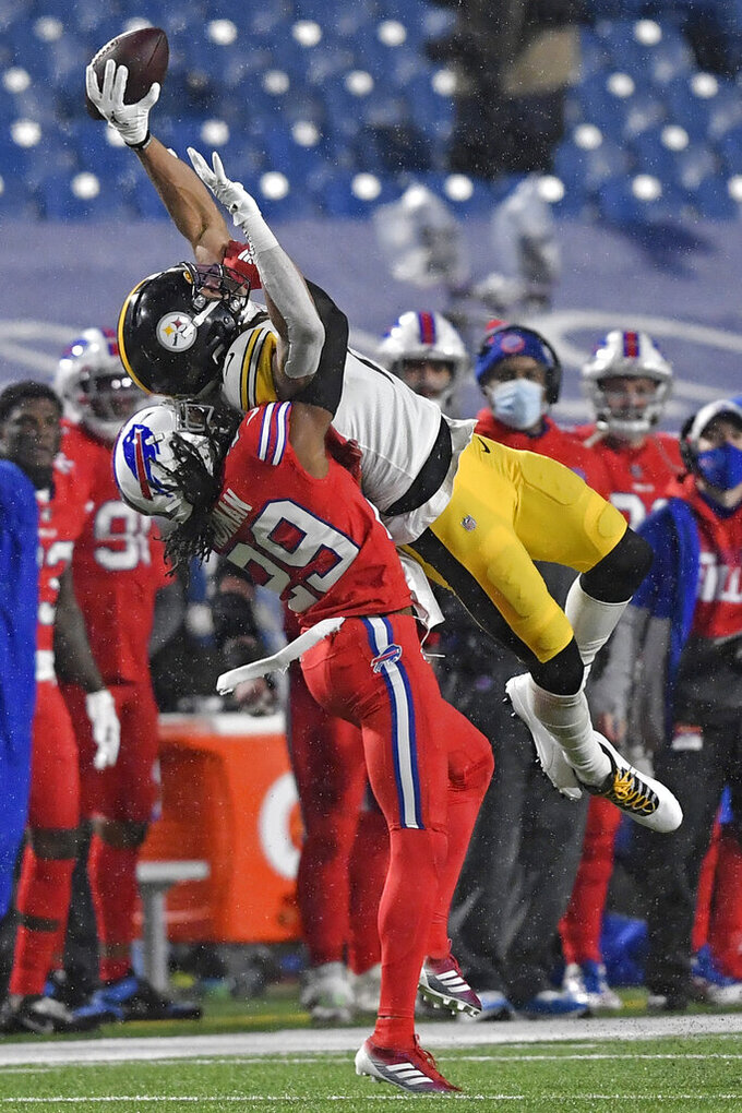 Pittsburgh Steelers wide receiver Chase Claypool (11) can't come down with a catch as Buffalo Bills cornerback Josh Norman (29) defends during the first half of an NFL football game in Orchard Park, N.Y., Sunday, Dec. 13, 2020. (AP Photo/Adrian Kraus)