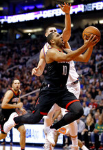 Houston Rockets guard Eric Gordon (10) slips past Phoenix Suns center Alex Len during the first half of an NBA basketball game, Friday, Jan. 12, 2018, in Phoenix. (AP Photo/Matt York)