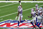 Buffalo Bills' Jerry Hughes, left, celebrates his interception during the second half of an NFL football game against the New York Jets, Sunday, Oct. 25, 2020, in East Rutherford, N.J. (AP Photo/Frank Franklin II)