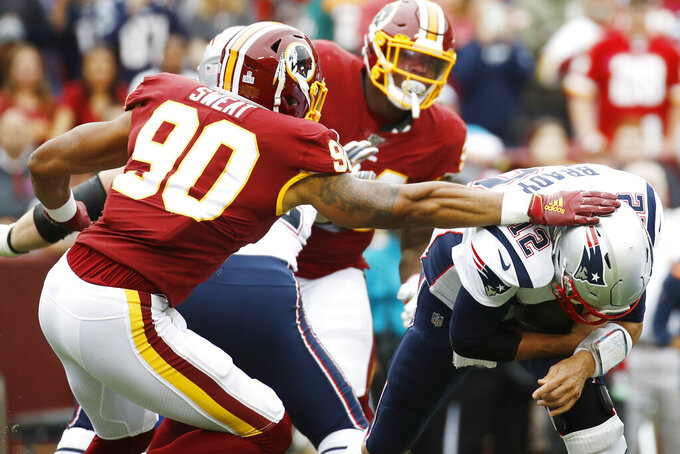 Washington Redskins linebacker Montez Sweat (90) pressures New England Patriots quarterback Tom Brady (12) during the first half of an NFL football game, Sunday, Oct. 6, 2019, in Washington. (AP Photo/Patrick Semansky)