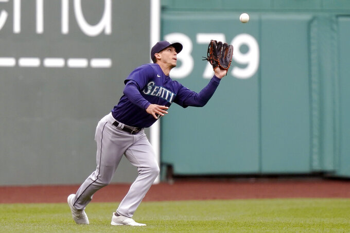Seattle Mariners' Sam Haggerty catches a fly ball by Boston Red Sox's Xander Bogaerts in the seventh inning of a baseball game, Sunday, April 25, 2021, in Boston. The Red Sox won 5-3. (AP Photo/Steven Senne)