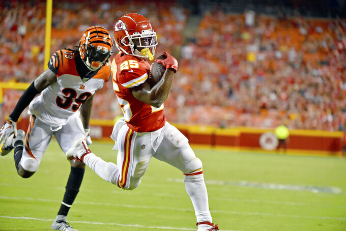 FILE - In this Aug. 10, 2019, file photo, Kansas City Chiefs running back Darwin Thompson (25) runs for a touchdown ahead of Cincinnati Bengals defensive back Tony Lippett (39) during the second half of an NFL preseason football game in Kansas City, Mo. Darwin Thompson had lasted until the sixth round of the NFL draft when the Chiefs finally selected him. Maybe teams were turned off by his size (5-foot-8) or his alma mater (Utah State). (AP Photo/Ed Zurga, File)