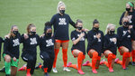 Players for the Houston Dash take a knee for the national anthem prior to their game against the Utah Royals FC during NWSL Challenge Cup at Zions Bank Stadium Tuesday, June 30, 2020, in Herriman, Utah. (AP Photo/Rick Bowmer)