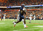 Syracuse wide receiver Jamal Custis (17) catches a pass along the sideline during the first half of an NCAA college football game against NC State in Syracuse, N.Y., Saturday, Oct. 27, 2018. (AP Photo/Adrian Kraus)