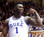 Duke's Zion Williamson (1) celebrates after he scored against North Carolina State during the second half of an NCAA college basketball game in Durham, N.C., Saturday, Feb. 16, 2019. (AP Photo/Chris Seward)