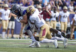 James Madison tight end Dylan Stapleton (84) fights for extra yards as he is brought down by Elon defensive backs Greg Liggs Jr. (21) and Efrim Borders (10) during the first half of an NCAA football game in Harrisonburg, Va., Saturday, Oct. 6, 2018. (Daniel Lin/Daily News-Record via AP)