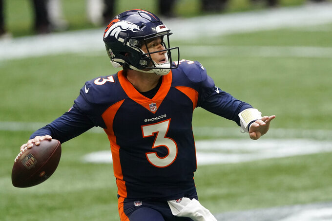 Denver Broncos quarterback Drew Lock (3) works in the pocket against the Denver Broncos during the first half of an NFL football game, Sunday, Nov. 8, 2020, in Atlanta. (AP Photo/John Bazemore)