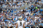 New Orleans Saints quarterback Drew Brees (9) looks around the playimng fdield during the first half of an NFL football game against the Carolina Panthers in Charlotte, N.C., Sunday, Dec. 29, 2019. (AP Photo/Brian Blanco)
