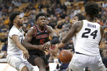 Georgia's Anthony Edwards (5) loses control of the ball on his way to the basket as Missouri's Torrence Watson, left, and Kobe Brown (24) defend during the first half of an NCAA college basketball game Tuesday, Jan. 28, 2020, in Columbia, Mo. (AP Photo/Jeff Roberson)