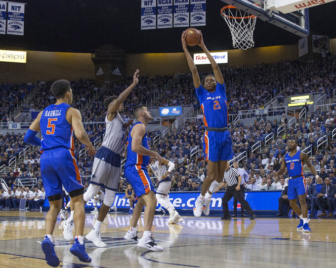 Boise State guard Derrick Alston (21) grabs a rebound in the first half of an NCAA college basketball game against Nevada in Reno, Nev., Saturday, Feb. 2, 2019. (AP Photo/Tom R. Smedes)