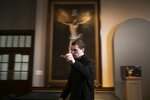 Seminarian John Paul Heisler gestures while walking through St. Charles Seminary in Wynnewood, Pa., on Wednesday, Feb. 5, 2020. The 188-year-old seminary is dotted with paintings of Bible scenes and reminders of papal visits. (AP Photo/Wong Maye-E)