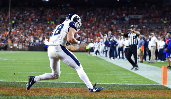 Los Angeles Rams wide receiver Cooper Kupp (18) catches an 11-yard touchdown pass during the second half of an NFL football game against the Cleveland Browns, Sunday, Sept. 22, 2019, in Cleveland. (AP Photo/David Dermer)