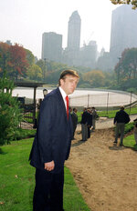 FILE - In this Oct. 23, 1986, file photo, Donald Trump is photographed in New York's Central Park, in front of the Wollman Skating Rink, which he offered to rebuild after the city's renovation effort had come to a standstill. Skaters may notice something missing from the park's two ice rinks this winter — President Donald Trump's name. The Trump Organization still operates the rinks but has removed the Trump name from the outer boards, the skate rental counters and elsewhere. (AP Photo/Mario Suriani, File)