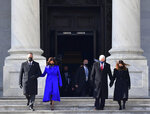 Vice President Kamala Harris, husband Douglas Emhoff, former Vice President Mike Pence and Wife Karen Pence walk down the east side steps of the U.S. Capitol after the Presidential Inauguration in Washington on Wednesday, Jan.  20, 2021.  (David Tulis/Pool Photo via AP)
