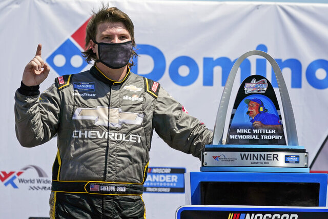 Sheldon Creed celebrates after winning a NASCAR Truck Series race at World Wide Technology Raceway on Sunday, Aug. 30, 2020, in Madison, Ill. (AP Photo/Jeff Roberson)
