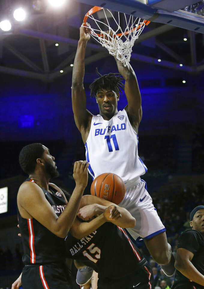 Buffalo forward Jeenathan Williams (11) dunks against Ball State during the first half of an NCAA college basketball game, Tuesday, Jan. 29, 2019, in Buffalo N.Y. (AP Photo/Jeffrey T. Barnes)