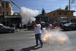 A Hezbollah supporter fires a rocket-propelled grenade in the air to celebrate the arrival of Iranian fuel tankers to Lebanon, in the eastern town of Baalbek, Lebanon, Thursday, Sept. 16, 2021. The delivery violates U.S. sanctions imposed on Tehran after former President Donald Trump pulled America out of a nuclear deal between Iran and world powers three years ago. (AP Photo/Bilal Hussein)