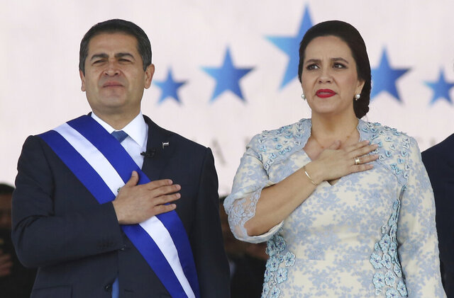 FILE - In this Jan. 27, 2018 file photo, Honduran President Juan Orlando Hernandez, left, stands with his wife Ana Garcia, during the presidential inauguration ceremony for his second term at the National Stadium in Tegucigalpa, Honduras. Hernández and his wife have tested positive for COVID-19, the Central American leader said late Tuesday, June 16, 2020, in a television message. (AP Photo/Fernando Antonio, File)