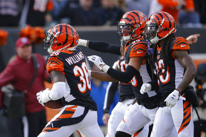 Cincinnati Bengals strong safety Shawn Williams (36) celebrates catching an interception during the first half an NFL football game against the Pittsburgh Steelers, Sunday, Nov. 24, 2019, in Cincinnati. (AP Photo/Gary Landers)