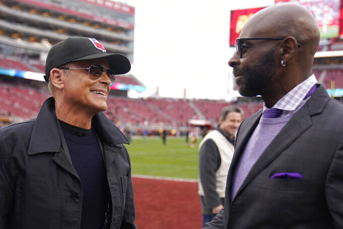 Actor Rob Lowe, left, talks with former wide receiver Jerry Rice before the NFL NFC Championship football game between the San Francisco 49ers and the Green Bay Packers Sunday, Jan. 19, 2020, in Santa Clara, Calif. (AP Photo/Tony Avelar)