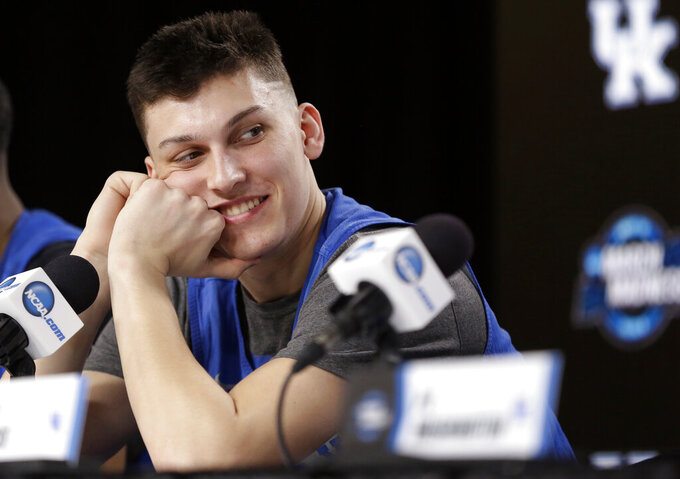 Kentucky's Tyler Herro looks over at head coach John Calipari during a news conference at the NCAA tournament college basketball tournament Saturday, March 30, 2019, in Kansas City, Mo. Kentucky is set to play Auburn in the Midwest regional final on Sunday. (AP Photo/Jeff Roberson)