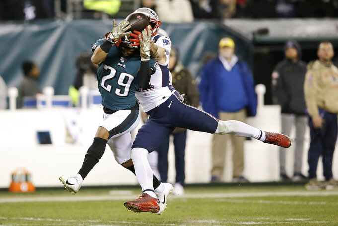 Philadelphia Eagles' Avonte Maddox (29) breaks up a pass intended for New England Patriots' Julian Edelman (11) during the second half of an NFL football game, Sunday, Nov. 17, 2019, in Philadelphia. (AP Photo/Michael Perez)
