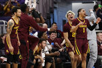 Minnesota players celebrate as they watch teammates during the second half of an NCAA college basketball game against Northwestern in Evanston, Ill., Sunday, Feb. 23, 2020. Minnesota won 83-57.(AP Photo/Nam Y. Huh)