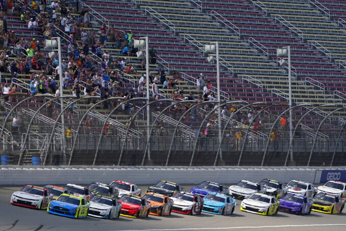 A.J. Allmendinger, left, and Austin Cindrec lead the field at the start of the NASCAR Xfinity Cup Series auto race at Michigan International Speedway, Saturday, Aug. 21, 2021, in Brooklyn, Mich. (AP Photo/Carlos Osorio)