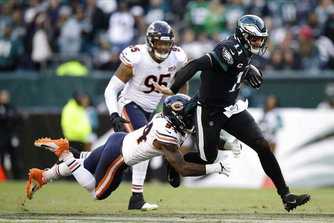 Philadelphia Eagles' Carson Wentz, right, is tackled by Chicago Bears' Leonard Floyd during the second half of an NFL football game, Sunday, Nov. 3, 2019, in Philadelphia. (AP Photo/Matt Rourke)