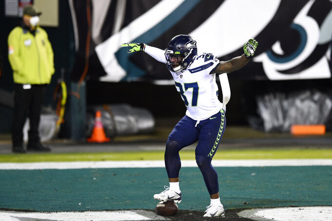 Seattle Seahawks' Quandre Diggs (37) reacts after intercepting a pass by Philadelphia Eagles' Carson Wentz during the second half of an NFL football game, Monday, Nov. 30, 2020, in Philadelphia. (AP Photo/Derik Hamilton)