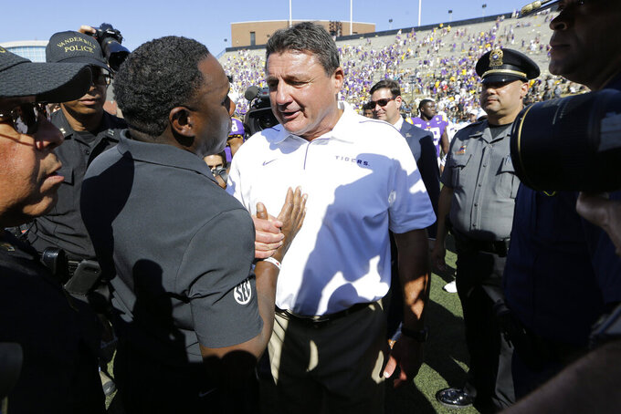 LSU head coach Ed Orgeron, right, and Vanderbilt head coach Derek Mason meet on the field after an NCAA college football game Saturday, Sept. 21, 2019, in Nashville, Tenn. LSU won 66-38. (AP Photo/Mark Humphrey)