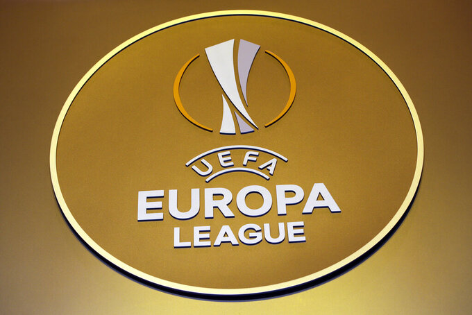 FILE - In this Friday, Aug. 31, 2018 file photo, the logo of the UEFA Europa League is displayed before the draw ceremony at the Grimaldi Forum, in Monaco. A player testing positive for COVID-19 forced a Europa League preliminary game to be postponed Thursday, Aug. 20, 2020. Its the fourth such incident in the early qualifying rounds for UEFA's club competitions that run through September and involve teams from 55 countries. (AP Photo/Claude Paris, file)