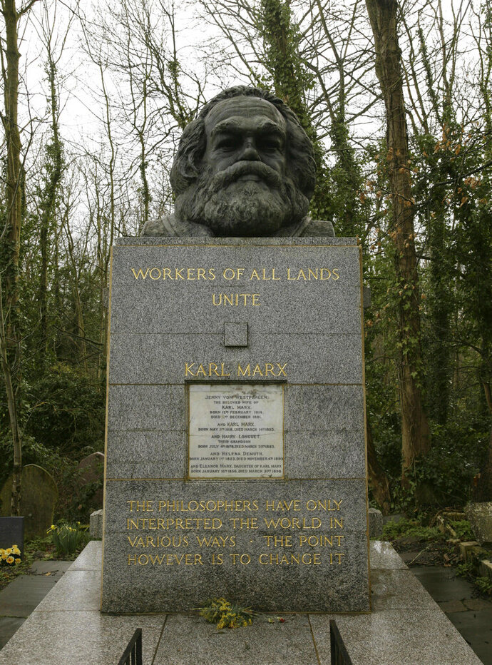 FILE - March 15, 2009 file photo of the grave of Marxist philosopher Karl Marx in Highgate Cemetery, in London. Custodians of a London cemetery say the tombstone of Communist thinker Karl Marx has been damaged in a hammer attack. The German philosopher was buried in Highgate Cemetery after his death in 1883, and his grave was later topped with a large granite bust bearing the words