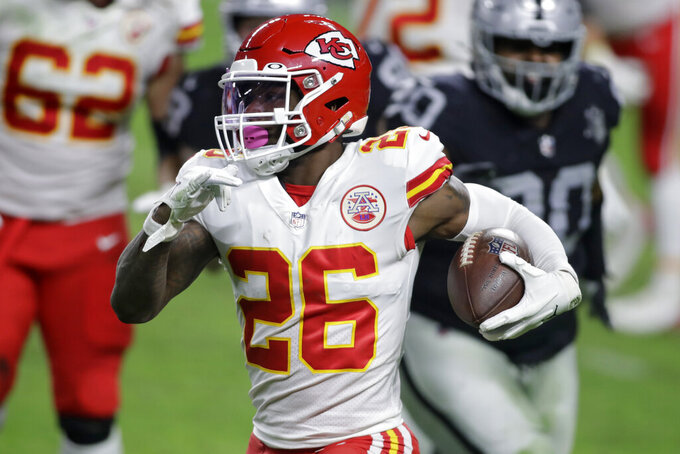 FILE - In this Nov. 22, 2020, file photo, Kansas City Chiefs running back Le'Veon Bell (26) carries the ball against the Las Vegas Raiders during the first half of an NFL football game in Las Vegas. Just a few years ago, Bell was arguably the best all-around running back in the league as a do-it-all playmaking force for Pittsburgh. Kansas City signed him and he wasn't much of a factor; he was active but didn't play in the Super Bowl. (AP Photo/Isaac Brekken, File)