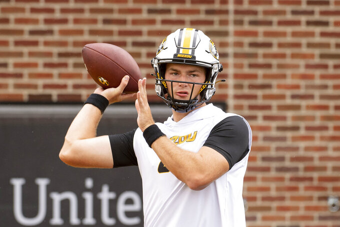 Missouri quarterback Connor Bazelak warms up before the start of an NCAA college football game against Central Michigan, Saturday, Sept. 4, 2021, in Columbia, Mo. (AP Photo/L.G. Patterson)