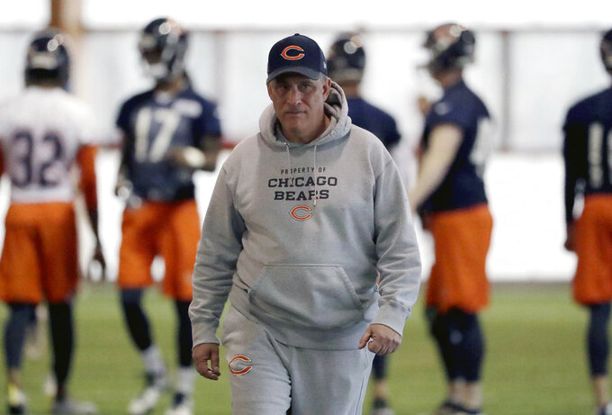 FILE - In this April 18, 2018, file photo, Chicago Bears defensive coordinator Vic Fangio watches players during the NFL football team's voluntary veteran minicamp in Lake Forest, Ill. A person with knowledge of the decision tells The Associated Press that Denver Broncos general manager John Elway has decided on Chicago Bears defensive coordinator Vic Fangio as his new head coach. The person spoke on condition of anonymity Wednesday, Jan. 9, 2019, because the team hadn't announced the hiring.(AP Photo/Nam Y. Huh, File)