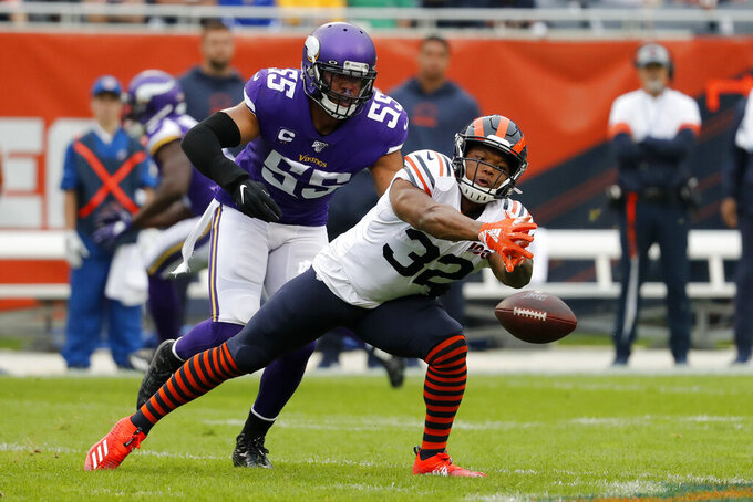 Chicago Bears running back David Montgomery (32) is unable to catch a pass as Minnesota Vikings outside linebacker Anthony Barr defends during the half of an NFL football game Sunday, Sept. 29, 2019, in Chicago. (AP Photo/Jeff Roberson)