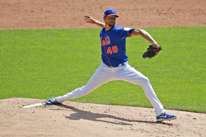 New York Mets starting pitcher Jacob deGrom throws during a simulated game at a baseball workout at Citi Field, Sunday, July 5, 2020, in New York. (AP Photo/Seth Wenig)