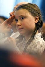 Swedish climate activist Greta Thunberg goes over her notes prior to her speech at an event at the EU Charlemagne building in Brussels, Thursday, Feb. 21, 2019. Thunberg will also participate in a climate march through the city later in the day. (AP Photo/Virginia Mayo)