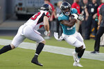 Jacksonville Jaguars fullback Ricky Ortiz, right, tries to get past Atlanta Falcons defensive back Parker Baldwin, left, during the first half of an NFL preseason football game, Thursday, Aug. 29, 2019, in Jacksonville, Fla. (AP Photo/John Raoux)